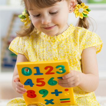 girl holding math tool