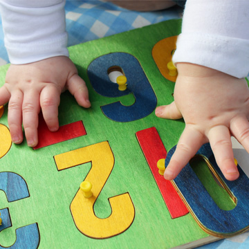 baby hands on a puzzle